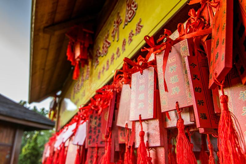 Tradicional buddhist prayer plates on red stock photos