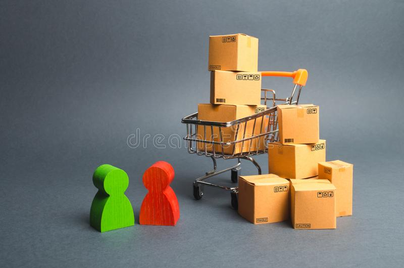 Trading car with boxes, a buyer and the seller, the manufacturer and the retailer. Business and commerce. Discussion of the terms. Of the transaction, the royalty free stock photography