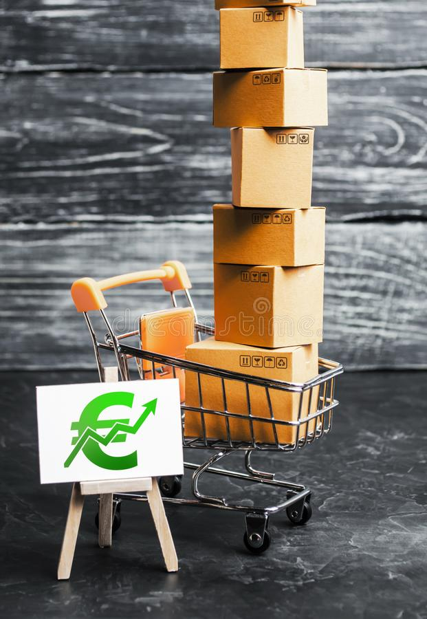Trading car with boxes and an easel with a green euro symbol. Positive trend. Advertising sale, marketing. Business strategy. Analysis. Shopping online. Growth royalty free stock image