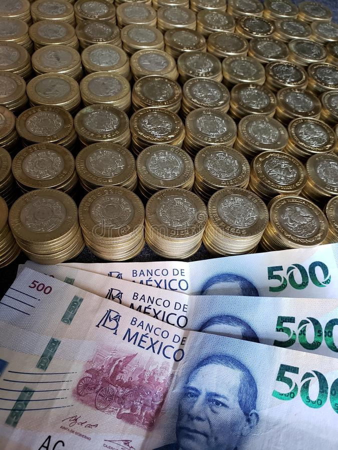 economic growth and trading, stacked coins of ten mexican pesos and banknotes of 500 pesos stock photography