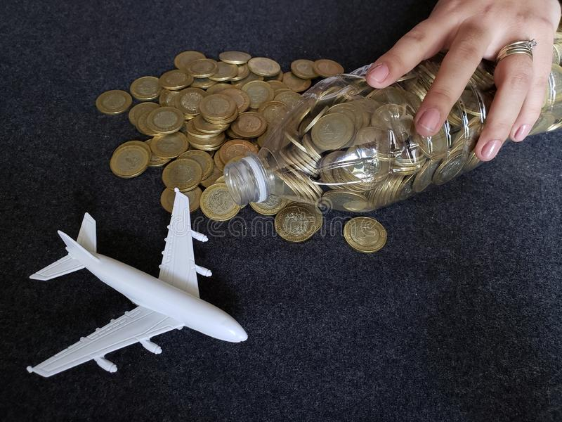 white airplane figure and savings in mexican pesos stock photo