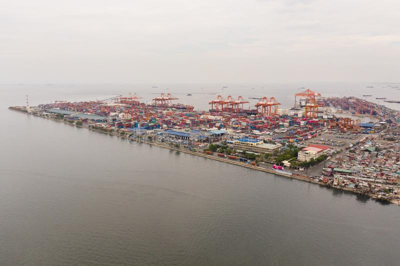 Trading port in Manila. Cargo cranes and containers in the port. Landscape stock image