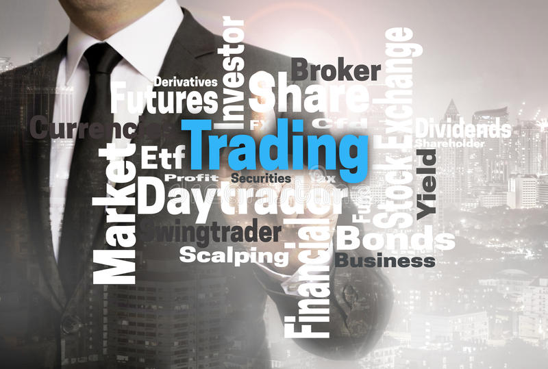 Trading wordcloud touchscreen is shown by businessman.  royalty free stock images