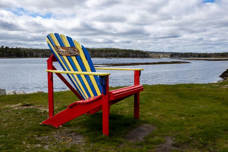 Tradionell canadian chair at a beach royalty free stock image