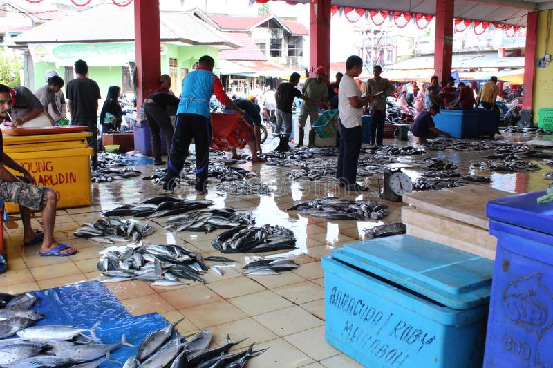Tradisional fish market in meulaboh aceh barat. Atmosphere traditional fish market in meulabuh aceh barat on daytime looks crowded stock photos