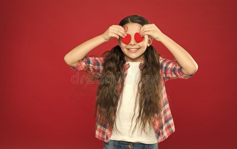 Tradition celebrate valentines day. Sincere love. Be my valentine. Family love. Girl cute child with hearts. Kid girl royalty free stock photos