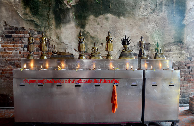 Tradition and culture of thailand, Thai people offering oil lamp. S to fill in the lamp of birthday at Wat Yai chaimongkol in Ayutthaya, Thailand stock photos