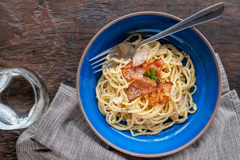 Tradition Italian food pasta carbonara, Spaghetti with bacon, ham and parmesan cheese. stock photo