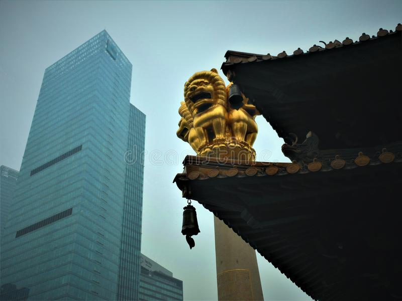 Tradition and Modernity in China. Ancient roof and modern skyscrapers, tradition and modernity in China stock images