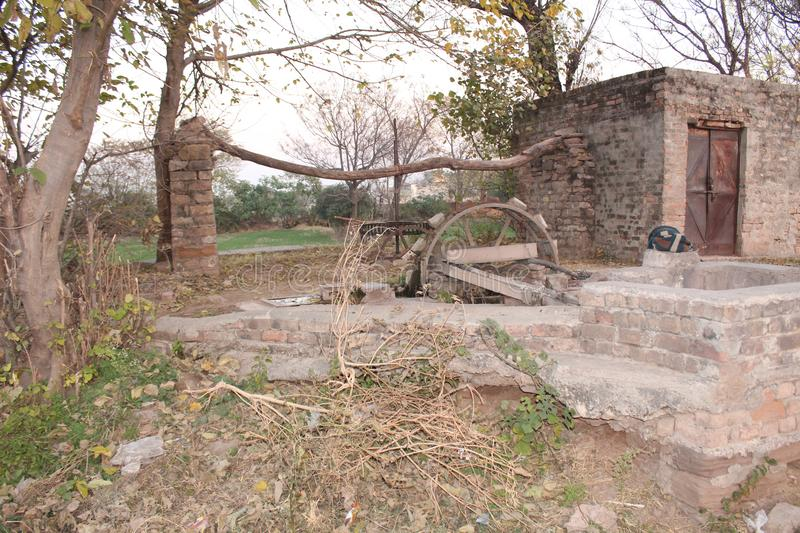 Tradition well in Punjab for irrigation. A picture of traditional well in Punjab which is used for the irrigation of lands by employing cows stock photo