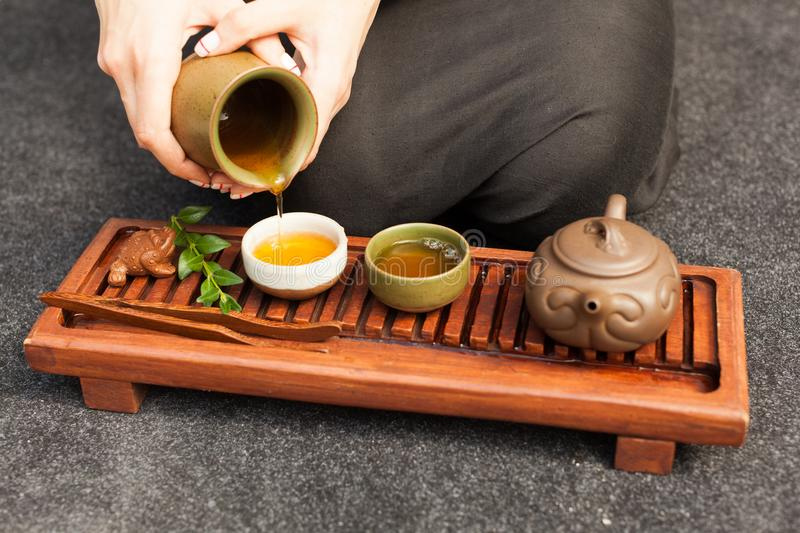 Traditional accessories for tea ceremony, black tea, green tea, oolong, puer, and chaban. Oriental beveradges. Calm meditation concept stock photos
