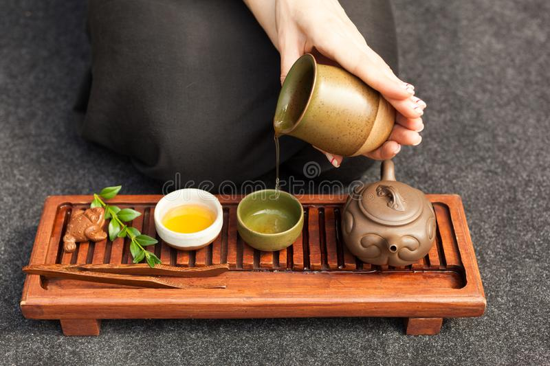 Traditional accessories for tea ceremony, black tea, green tea, oolong, puer, and chaban. Oriental beveradges. Calm meditation concept royalty free stock image