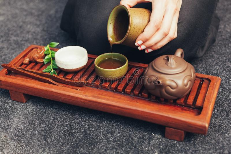 Traditional accessories for tea ceremony, black tea, green tea, oolong, puer, and chaban. Oriental beveradges. Calm meditation concept royalty free stock images