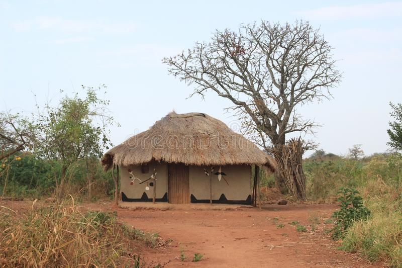Traditional African authentic huts and straw fences on the border of Zambia and Namibia stock photo