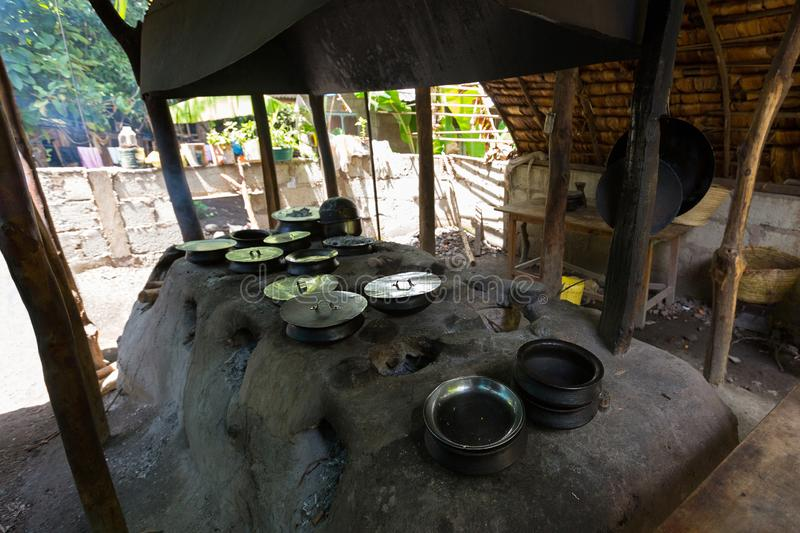 Traditional African food cooked inside Tanzanian clay pots on clay stove at Mto wa Mbu, village, Tanzania, Africa. Traditional African food cooked inside stock photos