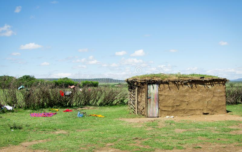 Traditional african masai hut with clothing scattered royalty free stock photos