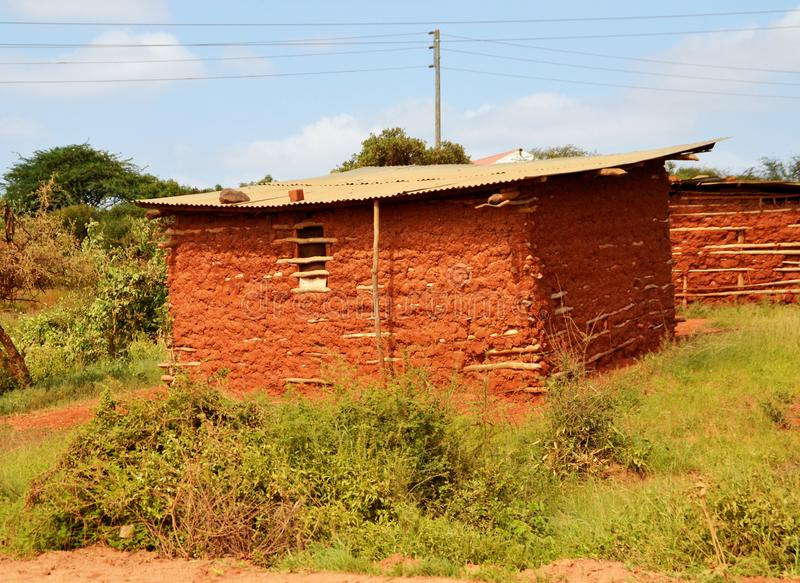 Traditional african mud house in Kenya stock images
