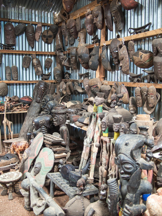Traditional African souvenir shop with wooden figures and masks royalty free stock images