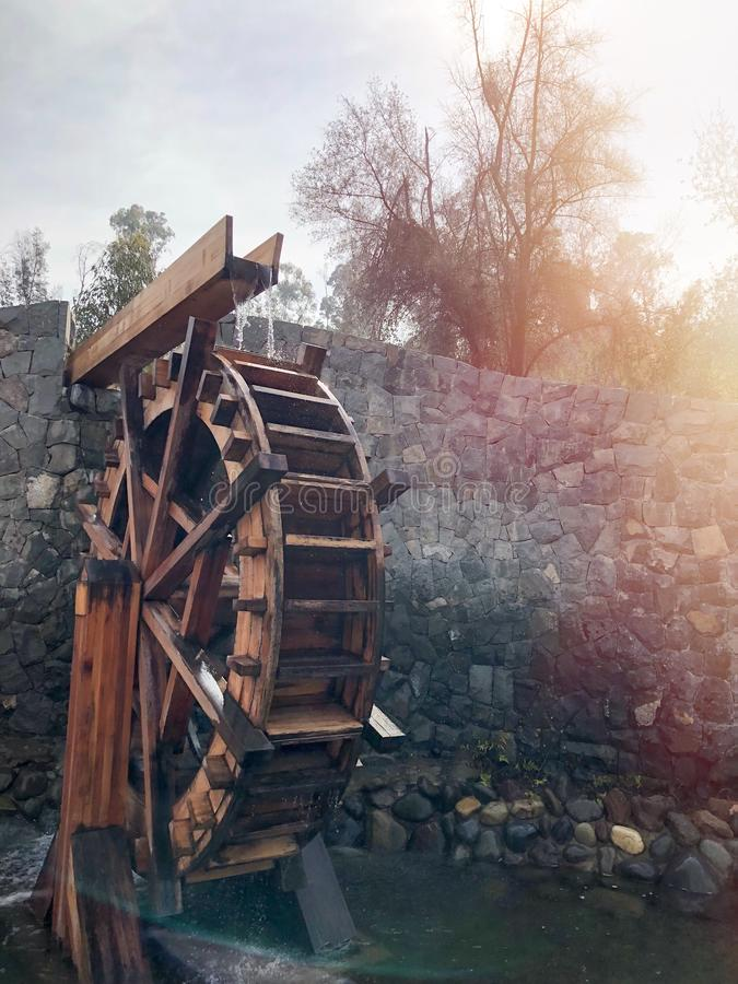Wooden water mill, water wheel, traditional agriculture. Traditional agriculture, old school architecture, retro, carpentry, moved to water stock photos