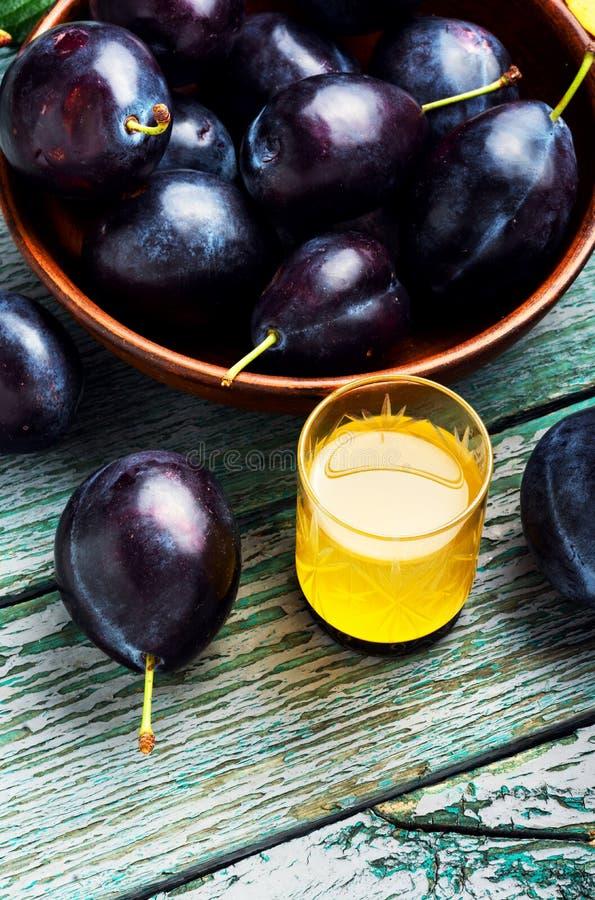 Plum alcoholic drink. Traditional alcoholic drink from the autumn plum harvest.Serbian rakia slivovitz stock image