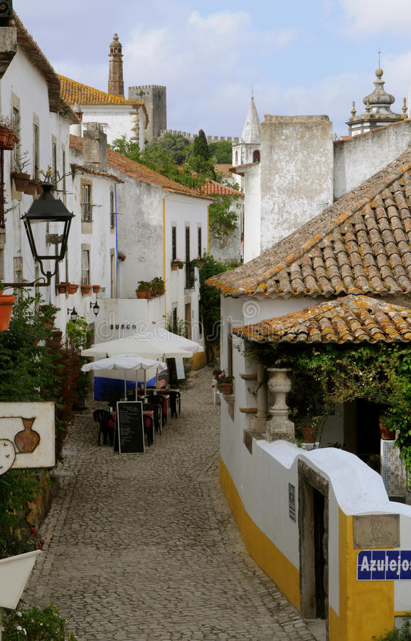 Typical Obidos Medieval Alley - Restaurant Terrace stock image