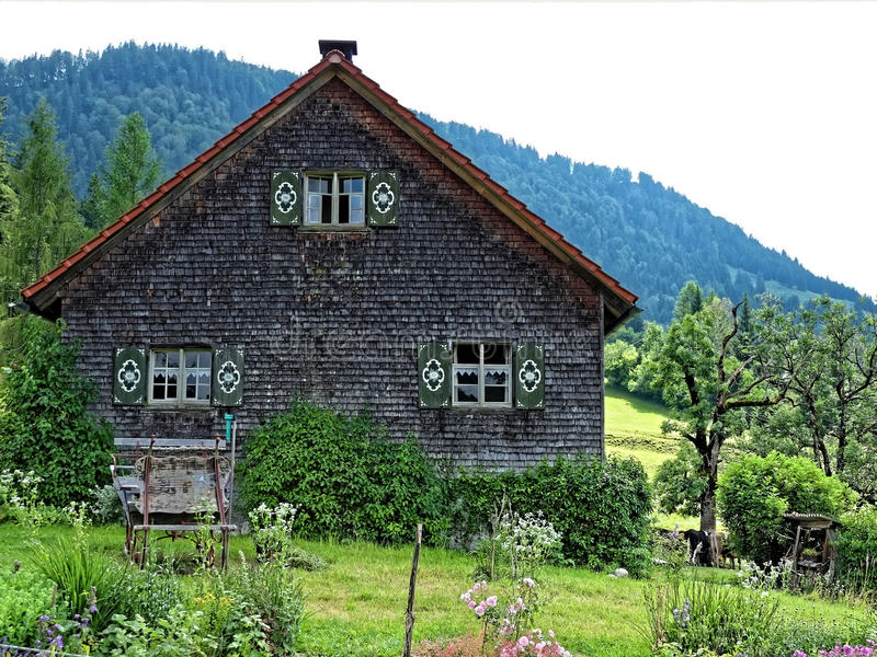 Traditional Allgau farmhouse. The traditional architecture of a farmhouse in the prealpine region of Allgau, Germany. Living remote and self-sufficient royalty free stock photos