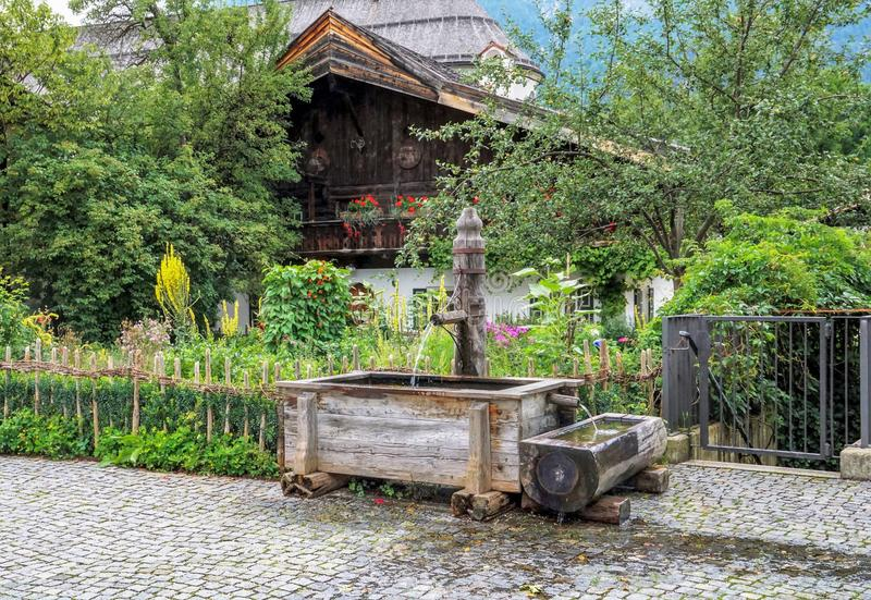 Traditional alpine fountain in Garmisch-Partenkirchen royalty free stock photo