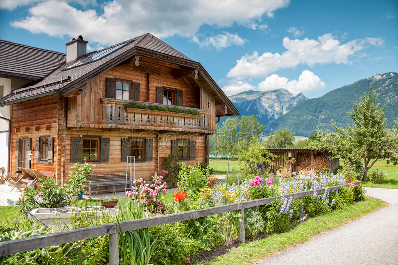 Traditional Alpine house in the mountains stock images