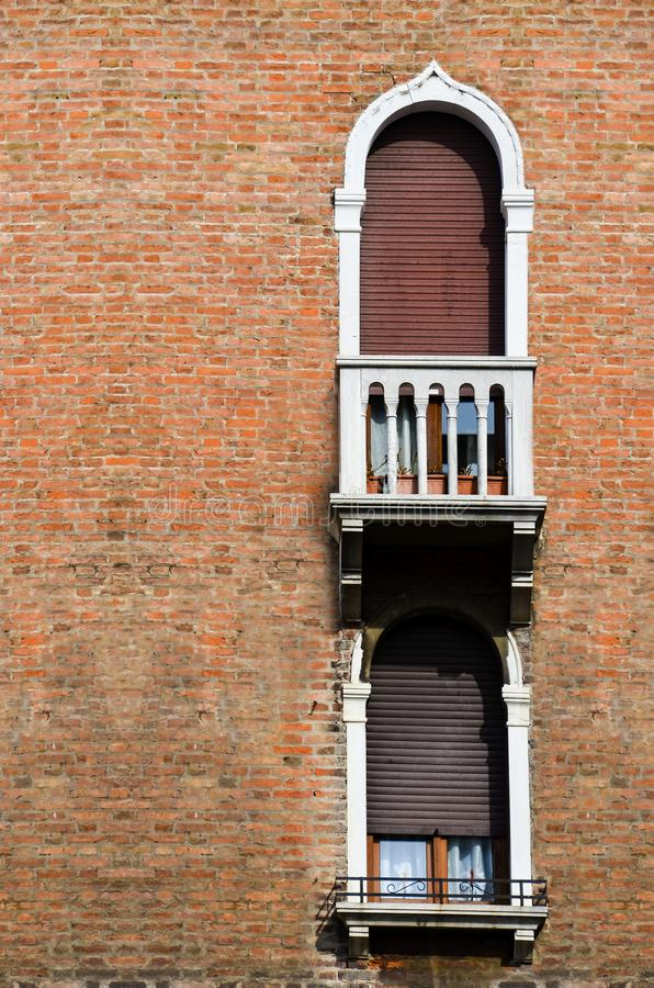 Traditional ancient gothic style window with flower pots in Venice stock image