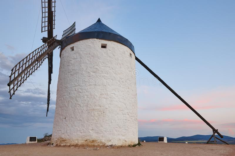 Traditional antique windmill at sunset in Spain. Consuegra, Toledo. Travel stock photos