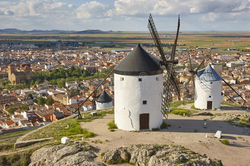 Traditional antique windmills and village in Spain. Toledo. Traditional antique windmills and village in Spain. Consuegra, Toledo royalty free stock image
