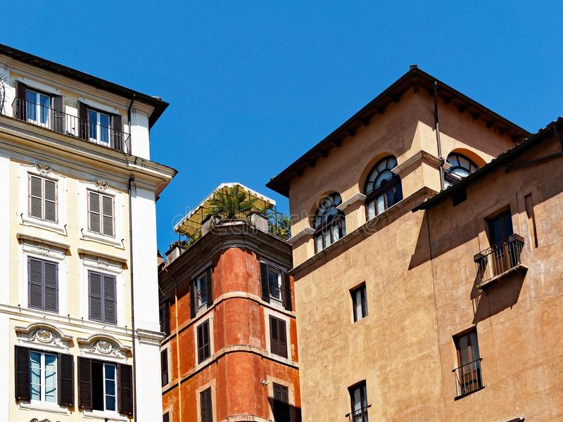 Traditional Apartment Buildings, Rome, Lazio, Italy. Traditional apartment buildings, one with a garden on top, showing three distinct architectural styles, in stock image