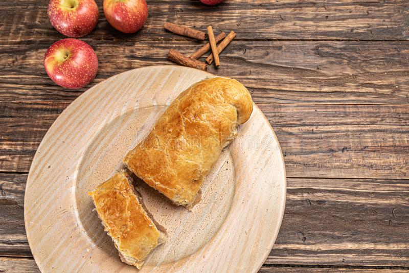 Traditional apple strudel on rustic wooden background stock image
