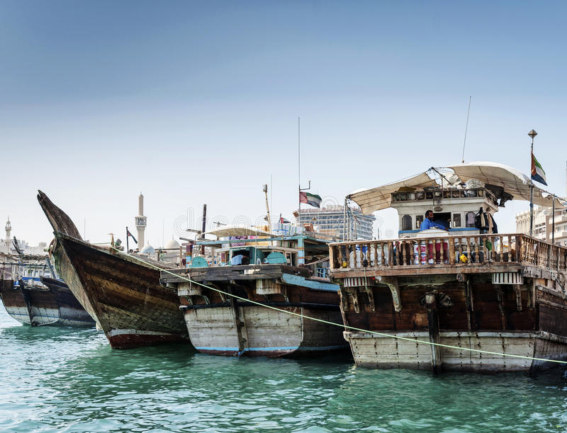 Traditional arabian dhow boats in deira harbour of dubai UAE royalty free stock photos