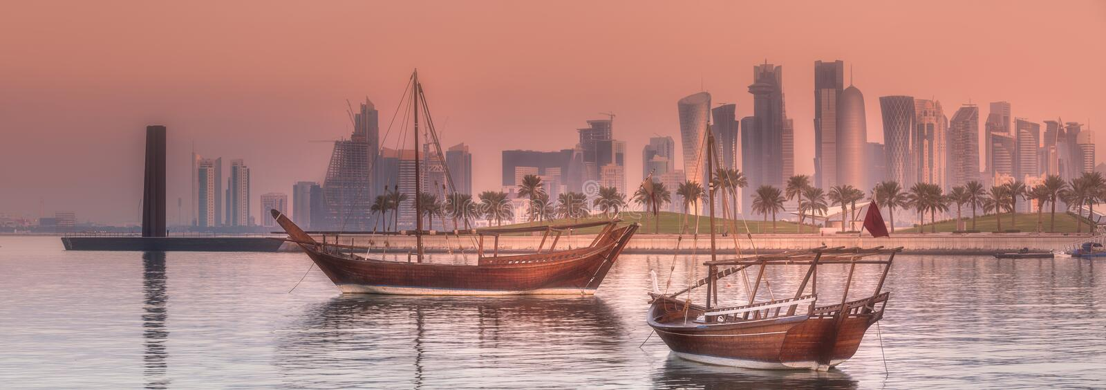 Traditional Arabic Dhow boats in Doha harbour, Qatar stock photos