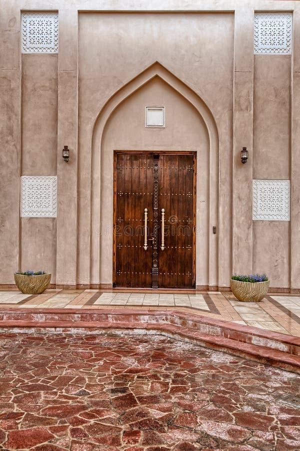 Traditional Arabic entry door in Doha, Qatar. stock photo