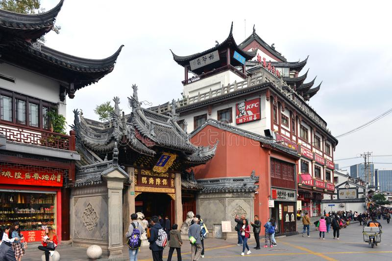 Traditional architecture and KFC restaurant in Shanghai. Shanghai, China - November 15, 2017: Traditional architecture in the busy Chenghuang Miao area in the royalty free stock photo