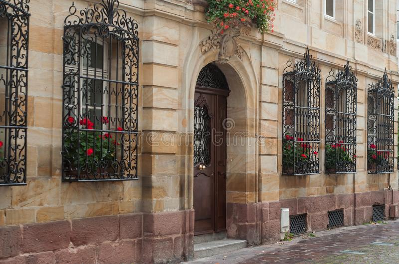 Traditional architecture in Mulhouse - France - stoned building with wooden door stock photo