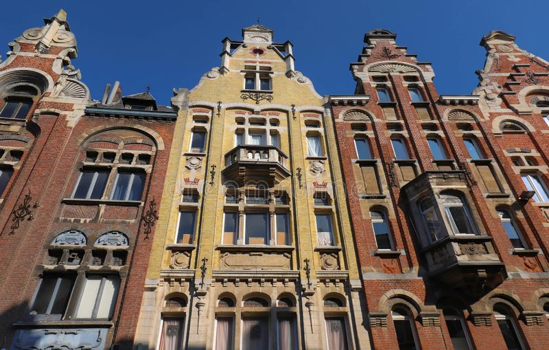 Traditional architecture with vivid facade of tall houses in Ghent. royalty free stock photo