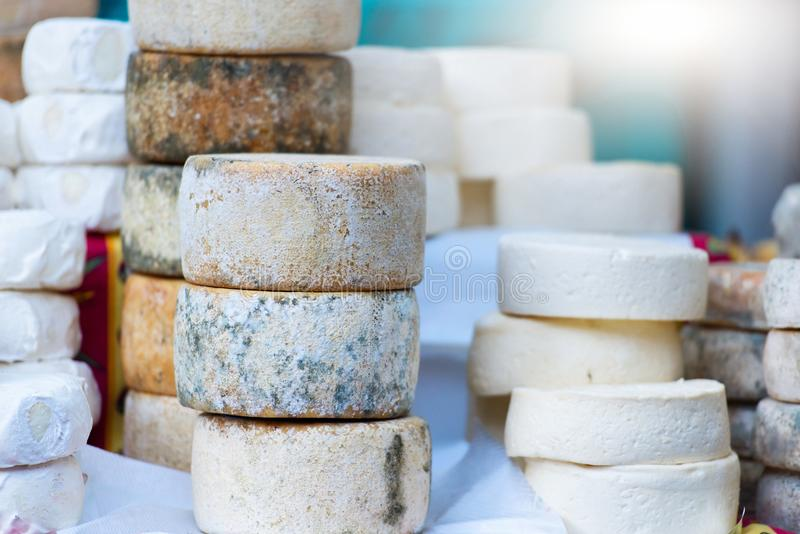 Traditional artisan cheese wheels composition.  stock images