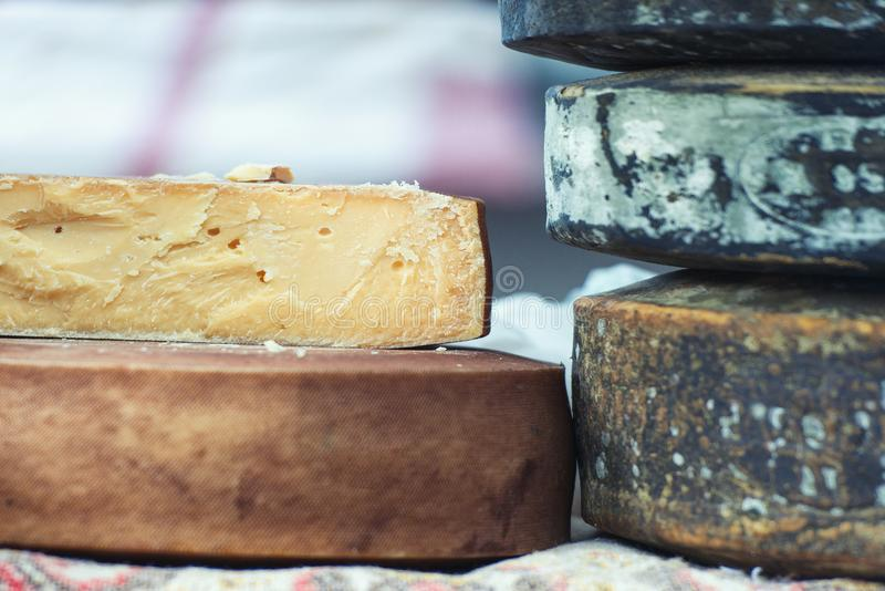 Traditional artisan cheese wheels composition.  stock image