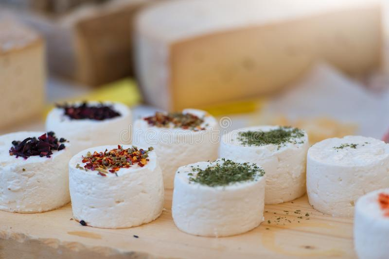 Traditional artisan goat cheese composition with spices and wild stock photo