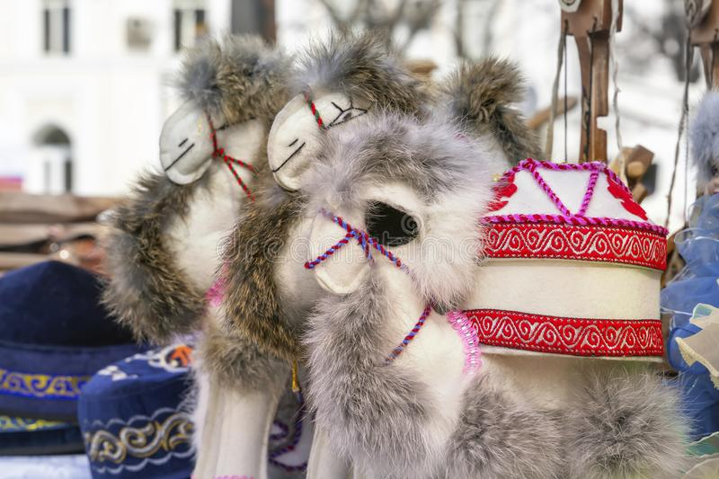 Traditional Asian handmade toys made of felt and fur are sold on the street market. royalty free stock photo