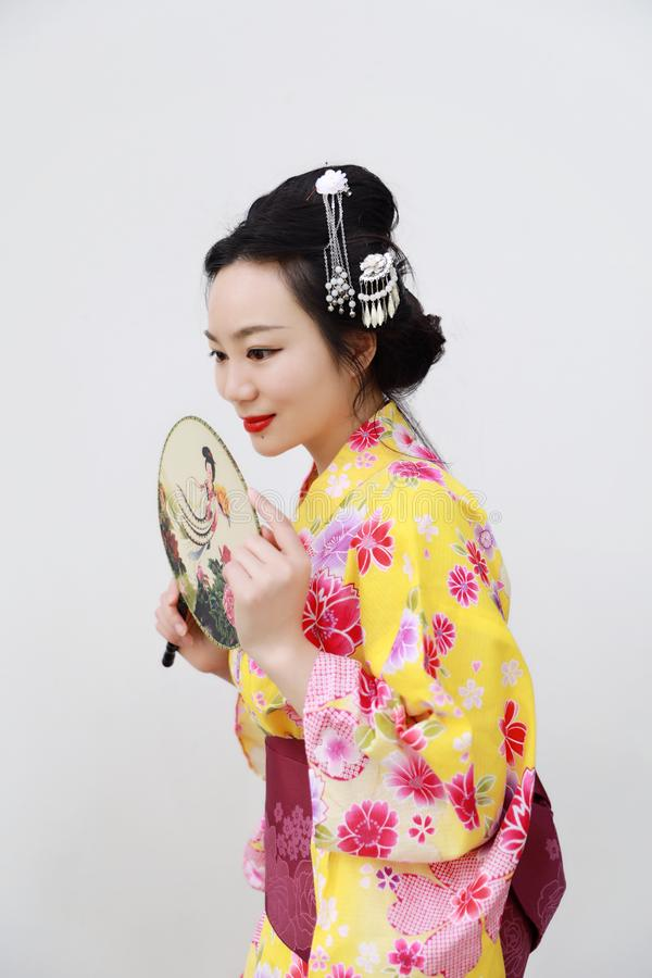 Traditional Asian Japanese woman with kimono with a fan on hand on isolated white background. Japanese woman with kimono Japanese bride smiling stand by bamboo stock photos