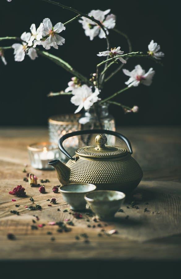 Traditional Asian tea ceremony arrangement over wooden background stock image