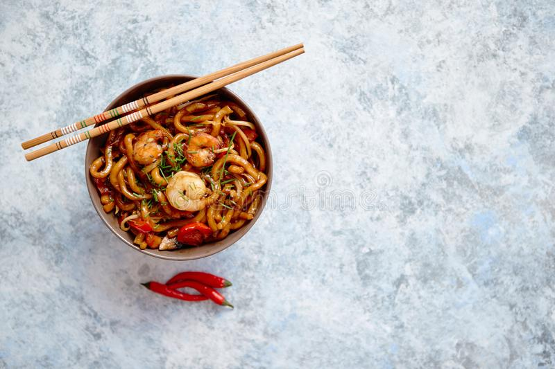Traditional asian udon stir-fry noodles with shrimp stock image