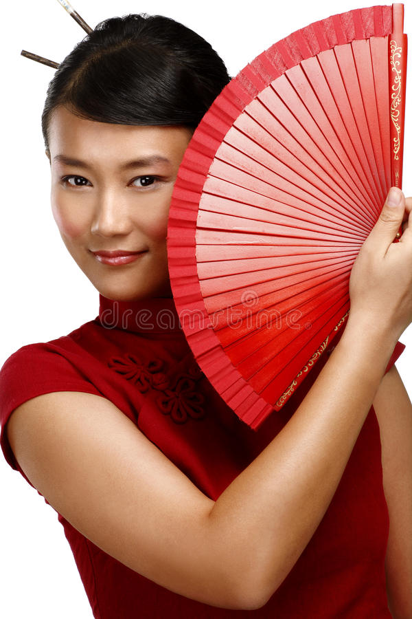 Traditional asian woman holding a red beautiful fan. On white stock image