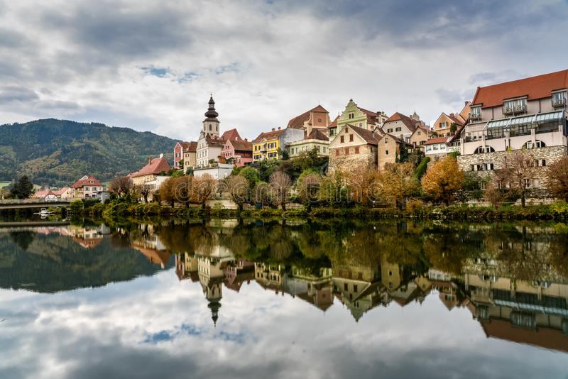Traditional Austrian Town. A traditional Austrian town reflected on the water royalty free stock photos