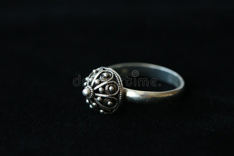 Traditional authentic Shibenik silver ring on black background. Shibenik button. Croatian vintage jewelry.  royalty free stock images