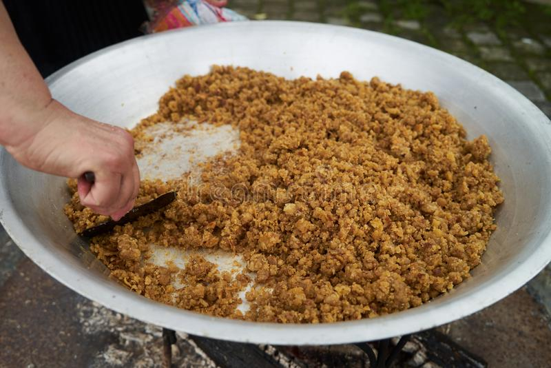 Traditional Azerbaijan food halwa cooking on bonfire, outdoors. Close-up stock images